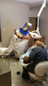 Manhattan KS Dentistry by Design member Justyna dressed as a molar